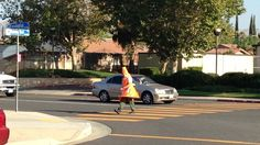 Cop dresses as traffic cone, issues tickets near a middle school to catch drivers who don't stop for pedestrians.