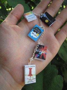 John Green keychain; I need to do this with all of my favorite books!!!  DIY: print out both the front and back covers (veryveryveryvery small) and transfer them onto a clay square.