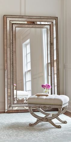 The Duchamps Storage Mirror, set in a wood frame with a multistep, silver painted and distressed finish, rests on the floor and attaches to the wall for stability. The felt-lined interior of this beveled antique mirror is specifically designed for organizing and storing your favorite treasures.
