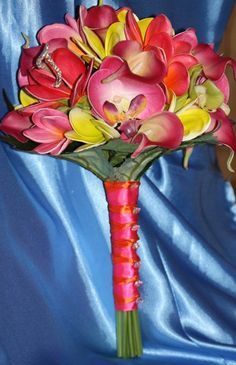 Tropical Bouquets on WeddingWire