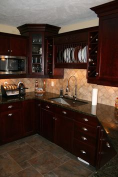 Cherry Kitchen Cabinets Black Granite dark granite with cherry cabinets and backsplash | kitchen ideas