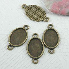 40pcs oval de bronce envejecido con forma de conector de configuración de cabujón EF0735 de callie6688 en Etsy https://www.etsy.com/es/listing/164270047/40pcs-oval-de-bronce-envejecido-con