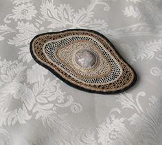 "Brooch ""Imprints"" by Lenka Veselá.  Needle lace with mineral stone. Cotton, linen, lace agate, imitation leather. Cca 11 x 6.5 cm"