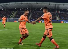 1b6bce7273 A joyous Coutinho heads to his Brazilian compatriot Roberto Firmino to  celebrate scoring Liverpool s second Philippe