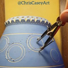 I've found that there is a specific angle at which the drill bit will bite, so I have to constantly adjust the way I'm holding the compass. The primary problem with this tool is that if the clay is too wet or there isn't enough pressure on the anchoring arm, it can shift and ruin the circle. It's a delicate operation. It's better to carve down layer by layer than try to do it all at once.