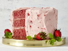 This vibrant pink layer cake is pure strawberry-on-strawberry goodness, with fresh strawberries going into the cake batter and frosting....