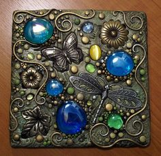 Butterfly Polymer Clay Plaque - Another amazing polymer clay art piece. Looks like metal, not clay. Love the embedded stones. Clay with stones. Maybe as pendants or art pieces, don't know yet. Mosaic Crafts, Mosaic Projects, Clay Projects, Clay Crafts, Arts And Crafts, Tile Art, Mosaic Art, Mosaic Glass, Mosaic Tiles