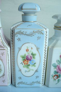 Vintage Perfume Bottle - the one on the right I have a pair with a matching vase. I wish I knew more about them.