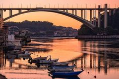 I took this photograph last week on my morning photo walk when I noticed these empty boats and reflection of the Arrabida bridge in the river Douro creating a sense of calmness where one would like to sit and just watch the Sunrise!  ______________________________________________________________	 Follow @anuragsvr for more upcoming content!! ____________________________________________________________________________________________________________________________	 #anuragsvr #porto…