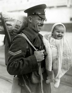 War and Conflict, World War Two, pic: 1945, Homecomings / Britain, A British soldier with his 8 month old daughter as he arrives at the docks from overseas (Photo by Popperfoto/Getty Images)