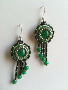 """Green & black Art Deco style bead embroidered earrings by Jeka Lambert.  Vintage glass """"jade"""" cabochons, seed beads."""