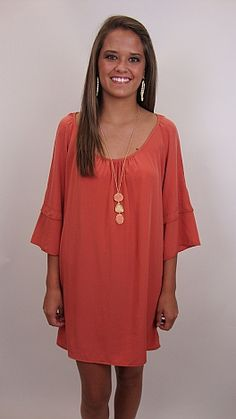Precious details such as cut-out sleeves, creamy fabric, rich rust hue, and bell sleeves make this a great dress for all occasions. Wear it anywhere, from a football game to a night on the town, to a day of shopping! We love this look with boots for fall!!  $56 www.shopbluedoor.com