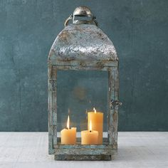 Gifts Under $100: The best lanterns look as thought they've been out on your patio or deck for years. This antiqued find is a stunner.   CoastalLiving.com
