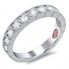 DemarcoJewelry.com  Available in White or Yellow Gold 18KT and Platinum. 0.51 RDCapture her grace and endless beauty with this confident yet elegant design. We have also incorporated a unique pink diamond with every single one of our rings, symbolizing that hidden, unspoken emotion and feeling one carries in their heart about their significant other. This is not just another ring, this is a heirloom piece of jewelry.   Demarco Bridal Engagement Ring.