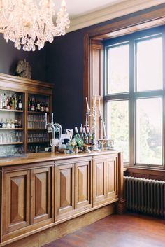 bar and cocktail area for wedding. wooden wall panels and crystal French chandelier Wedding Venues Uk, Beautiful Wedding Venues, Wedding Ceremonies, Wooden Wall Panels, French Chandelier, Wedding Planning Tips, Victorian Homes, Liquor Cabinet, Cocktail