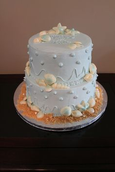 Beach themed cake - My first time making a tiered buttercream cake.  All handmade white chocolate shells brushed with sapphire and pearl shimmer.