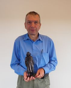 Prof. Michel Orrit with the coveted Spinoza statue https://www.universiteitleiden.nl/en/news/2017/09/michel-orrit-receives-spinoza-prize-in-royal-theatre