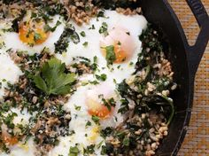 Toasted barley and wilted kale served with lemon zest, cheese, and baked eggs, all cooked in a single skillet.