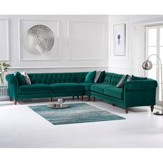 Provide your living room with a dramatic centrepiece with the Livi Green Velvet Corner Sofa, a generously-sized choice that is capable of accommodating as many as 4 people over the length of two sofas. Corner Sofa Living Room, Living Room Sofa Design, Living Room Green, Living Room Sets, Home Living Room, Living Room Designs, Living Room Decor, Green Living Room Furniture, Corner Sofa Design