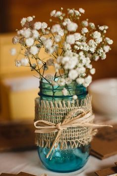 Cute little centerpieces, inexpensive and easy to make, perfect for our Spring Meeting. Just a Mason Jar, Burlap Ribbon, a bit of Raffia, and some Baby's Breath. We added dollar store battery-operated Tea Lights to the jar for a little extra ambiance... ~~ Houston Foodlovers Book Club