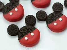 Mickey Mouse Cookies:  Ingredients Regular sized oreos Mini oreos Red candy melts Chocolate candy melts White round sprinkles  1. Heat candy melts(according to package) 2. Dip 1/2 oreo into red candy and place on wax paper 3. Place 2 sprinkles for buttons 4. Glue on mini cookies with the chocolate candy to make ears. 5. Let candy set or place in refrigerator for 5 mins.