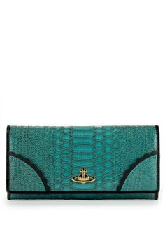 In a feminine faux snakeskin fabric, Vivienne Westwood's Frilly Snake Purse is produced in vivid turquoise with a contrasting black patent frill trim. Finished with iconic Orb logo and stud fastening, its soft black leather interior has space for eight cards along with a full length zip closing coin compartment and three note/receipt slots.