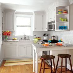 "To make the room seem larger, she suggested glass subway tile and other light-reflecting finishes, like pale granite and red-oak flooring. The cabinets fit together precisely, with a pullout for spices and oils, squeezed in near the range, ""in a frameless cabinet, which offers a bit more space inside than one with an inset door,"""