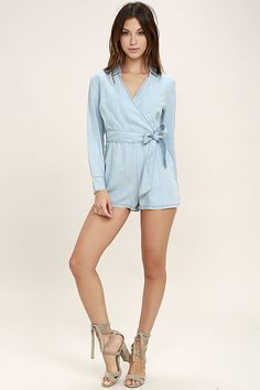Show off your sassy side in the BB Dakota Carlisle Blue Chambray Romper! Light wash chambray shapes a collared neckline, wrap bodice (with darting and hidden snap closures), and long sleeves with button cuffs. A fitted waist, with tying sash, falls into flirty shorts. Hidden side zipper.