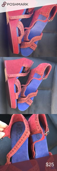 Toms suede red/blue espadrille wedges New without tags. Never worn beautiful deep red leather with vibrant blue sole. Mint condition. Hard to find. Toms Shoes Espadrilles