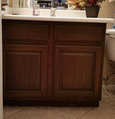 Antique walnut general finishes gel stain on a maple bathroom vanity.