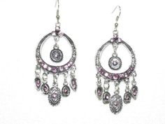 """Dangle earrings in silver with purple rhinestones. Measures 2-1/2"""" long.  $2.00  Available at www.blingychics.com"""