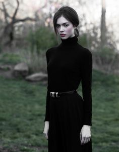 I love everything about this haunting picture...makeup, hair, attire, and location! What a pale beauty