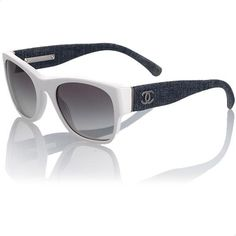 37221443c5 These exclusive Chanel sunglasses have white frames with unique arms that  are tightly wrapped with dark denim. Metallic  CC  logos adorn the temples  and ...