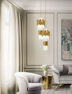 Inspired by the stunning architectural building, the Empire Pendant by LUXXU creates a unique ambiance to the space. #livingroomideas #luxuryhomes #interiordesign modern design, luxury lighting, ambient lighting. See more at www.luxxu.net