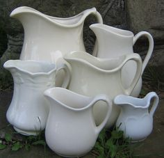 .....old ironstone pitchers  -  I have a collection of these sitting on my shelves too!