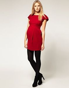 Christmas and New Year outfit ideas during pregnancy, including this smart red dress.