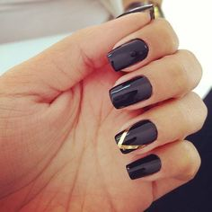 Dark nails with design on ring finger