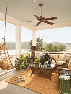 A covered porch off the master bedroom provides a comfortable vantage point for watching boats come and go in the harbor. The interior decorator treated the private space as an open-air sitting room, complete with area rug, table lamps, and cozy seating.