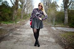Floral print shirt with black leather skirt, pantyhose and heels