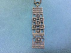 "Pentti Sarpaneva for Turun Hopea (FI), ""Pitsi"" (Lace) vintage bronze hinged pendant, 1970s. #finland | finlandjewelry.com"