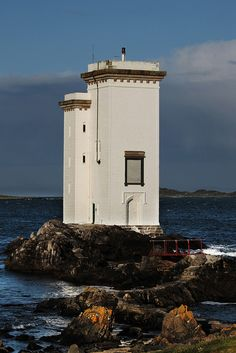 CARRAIG FHADA Lighthouse, Port Ellen, Islay. The lighthouse was erected in 1832 by John Frederick Campbell in memory of Lady Ellinor Campbell.Scotland