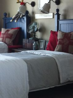 Double bed boys room-bedding and blue headboards