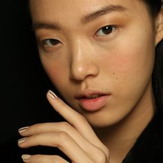 Fall Beauty Trends You Should Know About | Keep things straight and to the point with single stripe of red on a nude nail like at Prabal Gurung (pictured), off-center red, white, and blue lines at Nonoo, and full-on graph paper grids at Ann Yee.