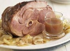 A country-style ham with bone is cooked with apple & onion in the crock pot, in a mixture of apple cider, brown sugar, maple syrup & apple pie spice.