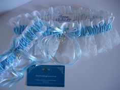 Something Blue Garters. White and Light Blue personalized wedding garter set with silver double heart charms.  TheWeddingGarter.com