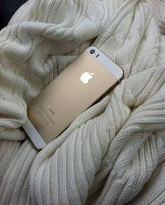 so pretty. gold iphone + ivory throw.
