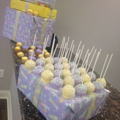 Lavender and yellow baby shower; decor by HYR Designs. Cake pops and cupcakes by Barbara Ferguson.