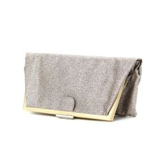 A little glitter never hurt anyone. Click to buy this Valentina clutch.
