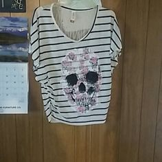 Flowy Skull Face Top Great condition. Its has a large floral skull face on the front. Its nice  and flowy when worn. Its a size small. If any questions please ask. Tops Blouses