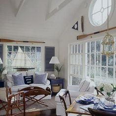 Dinner Cruise. . .hurricane flag, oars for window treatments, large sail boat, indoor shutters, blue end table, large basket
